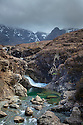 The Fairy Pools, a series of crystal clear pools created by the Allt Coir' a' Mhadaidh river as it cascades down from the Cullin Hills, Glen Brittle, Isle of Skye, Inner Hebrides, Scotland, UK. April.