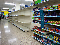 Empty shelves in a Tesco store in the town centre on March 19, 2020 in High Wycombe, United Kingdom during the COVID-19 pandemic causing people to panic buy items. Photo by Andy Rowland.