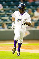 Jared Mitchell #24 of the Winston-Salem Dash spits as he runs down the first base line against the Wilmington Blue Rocks at BB&T Ballpark on August 3, 2011 in Winston-Salem, North Carolina.  The Blue Rocks defeated the Dash 6-2.   Brian Westerholt / Four Seam Images