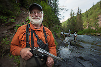 "150620-JRE-7981E-0857 ""Fly Bob,"" a senior guide for Kenai Cache outfitters is loaded for bear as his clients fish the Russian River."