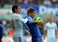 Saturday, 03 November 2012<br /> Pictured L-R: Angel Rangel of Swanseaand Fernando Torres of Chelsea <br /> Re: Barclays Premier League, Swansea City FC v Chelsea at the Liberty Stadium, south Wales.