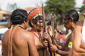 Altamira, Brazil. Kayapo Indian warriors discussing.