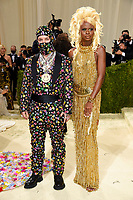 """J Balvin, left, and Symone attend The Metropolitan Museum of Art's Costume Institute benefit gala celebrating the opening of the """"In America: A Lexicon of Fashion"""" exhibition on Monday, Sept. 13, 2021, in New York. (Photo by Evan Agostini/Invision/AP)"""