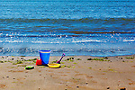 Childs Toy Bucket on Beach, Sunset Bay, Oregon Coast, Cape Arago, Oregon CoastSandy beaches of Sunset Bay State Park, which offers camping, fishing, hiking and day use facilities.  Cape Arago on the Central Oregon Coast with views of Sunset State Park and the Umpqua River Lighthouse, and massive headlands. Near Coos Bay, Oregon, Cape Arago is known for its rugged views, hiking, wildlife, beach access, and Sunset Beach State Park and unique geology.