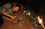 Chasing the dragon opium addict Northern Thailand South east Asia. Chiang Rai province. 1990s