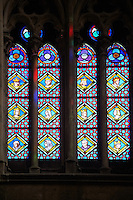 12th century medieval Gothic stained glass window showing  Kings and Queens of France. The Gothic Cathedral Basilica of Saint Denis ( Basilique Saint-Denis ) Paris, France. A UNESCO World Heritage Site.