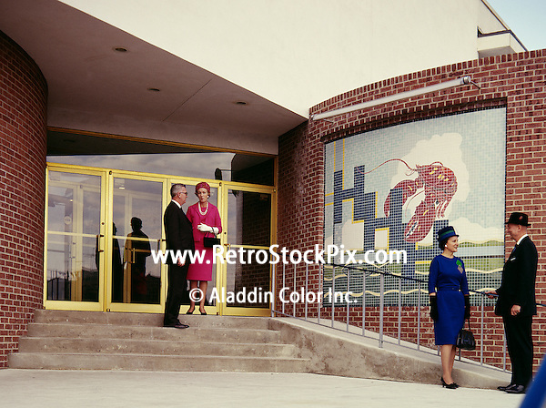 Senior couple standing outside hotel