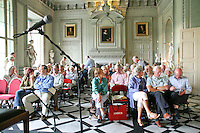 Audience waiting for a performance by Martin Taylor, solo jazz guitarist, Petworth House, Petworth Festival, West Sussex.