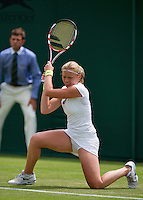 25-06-13, England, London,  AELTC, Wimbledon, Tennis, Wimbledon 2013, Day two, Michaella Krajicek (NED) on her knees for Li Na<br /> <br /> <br /> <br /> Photo: Henk Koster