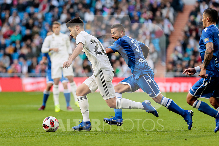 Real Madrid's Marco Asensio and UD Melilla's Jilmar during Copa del Rey match between Real Madrid and UD Melilla at Santiago Bernabeu Stadium in Madrid, Spain. December 06, 2018. (ALTERPHOTOS/A. Perez Meca)
