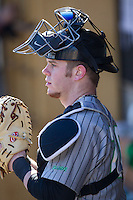 Travis Wildermuth (20) of the Marshall Thundering Herd watches the action from the dugout during the NCAA baseball game against the Georgetown Hoyas at Wake Forest Baseball Park on February 15, 2014 in Winston-Salem, North Carolina.  The Thundering Herd defeated the Hoyas 5-1.  (Brian Westerholt/Four Seam Images)
