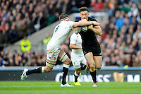 Sonny Bill Williams of New Zealand is tackled by Tom Wood of England during the QBE International match between England and New Zealand at Twickenham Stadium on Saturday 8th November 2014 (Photo by Rob Munro)