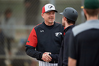 Edgewood Eagles head coach Al Brisack shakes hands with Adam Skonieczki after a game against the South Vermont Mountaineers on March 18, 2019 at Lee County Player Development Complex in Fort Myers, Florida.  South Vermont defeated Edgewood 19-6.  (Mike Janes/Four Seam Images)