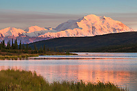 Canoe on Wonder Lake with alpenglow on Denali, Denali National Park, Interior, Alaska