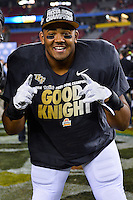 January 01, 2014:<br /> <br /> UCF Knights linebacker Domenic Spencer #50 at the conclusion of Tostitos Fiesta Bowl at University of Phoenix Stadium in Scottsdale, AZ. UCF defeat Baylor 52-42 to claim it's first ever BCS Bowl trophy.