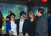 Guests in masks at a Halloween party.