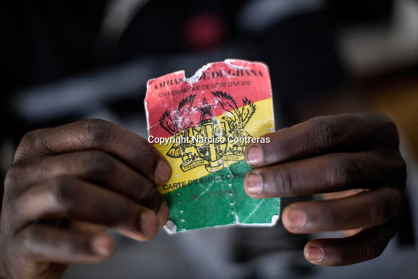 A travel document held by an African migrant from Ghana in a Surman detention centre, west of Libya.