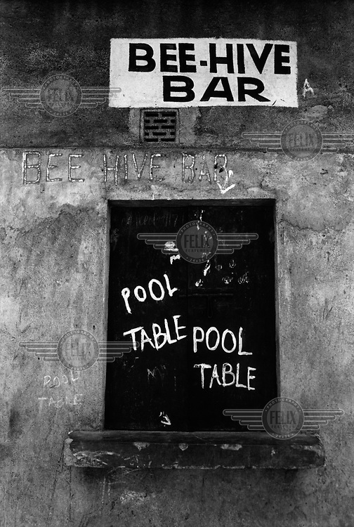 Sign outside the Bee-hive bar in the Soweto slum, advertising its pool table.