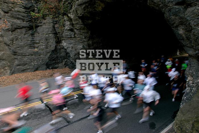 Runners emerge from a tunnel on Kelly Drive during the Philadelphia Marathon in Philadelphia, Pennsylvania on November 19, 2006.