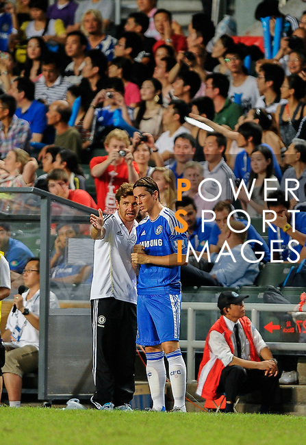 Andre Villas-Boas of Chelsea gives instructions to Fernando Torres during the Asia Trophy Final match against Aston Villa at the Hong Kong Stadium on July 30, 2011 in So Kon Po, Hong Kong. Photo by Victor Fraile / The Power of Sport Images