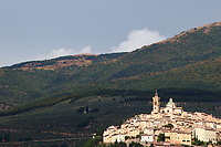 Foligno: A view from far away of the top of the hill where is located the historical center, with green mountains on the background, and a beautiful late afternoon light . This is an enlargement of part of the original image.
