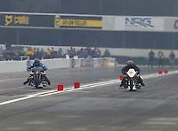 Feb 10, 2017; Pomona, CA, USA; NHRA top fuel nitro Harley rider Jay Turner (left) races alongside Kevin Boyer during qualifying for the Winternationals at Auto Club Raceway at Pomona. Mandatory Credit: Mark J. Rebilas-USA TODAY Sports