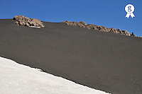 Italy, Sicily, Etna Volcano,  Ash lava field in between rocks and snow (Licence this image exclusively with Getty: http://www.gettyimages.com/detail/sb10069714x-001 )