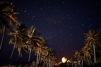 Palm trees and a radar dome are seen under the night sky on the U.S. Army base on Kwajalein, part of the Ronald Reagan Ballistic Missile Defense Test Site, in the Marshall Islands on June 12, 2012. The U.S. base has been used since 1946 as a staging ground for nuclear bomb tests conducted at Bikini Atoll and then as a range for long-range ballistic tests. Around one-thousand American defense contractors and U.S. military soldiers live on Kwajalein.