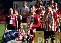 29th May 2021; Wembley Stadium, London, England; English Football League Championship Football, Playoff Final, Brentford FC versus Swansea City; Sergi Canos of Brentford lifts the Sky Bet EFL Championship Plays-off Trophy with his team mates after they won 2-0 and promoted to the premier league