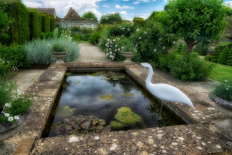 The White Garden with heron sculpture. Bourton House Garden. The Cotswolds, England