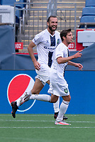 FOXBOROUGH, MA - JULY 4: Marios Lomis #9 of Greenville Triumph SC celebrates his first goal during a game between Greenville Triumph SC and New England Revolution II at Gillette Stadium on July 4, 2021 in Foxborough, Massachusetts.