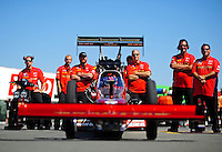 Jul. 17, 2010; Sonoma, CA, USA; NHRA top fuel dragster driver David Grubnic sits in his car as crew members wait alongside during qualifying for the Fram Autolite Nationals at Infineon Raceway. Mandatory Credit: Mark J. Rebilas-