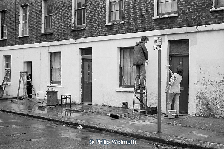 """""""Paint-in"""" in Carol Street, a row of squatted houses in Camden Town, London, which was later granted short-life status and subsequently became a council-supported housing co-operative."""