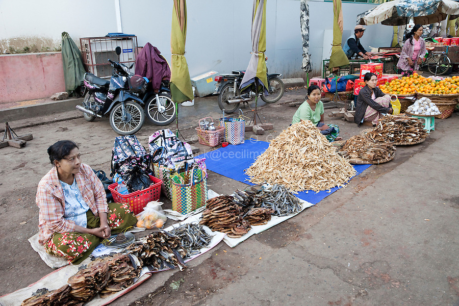 Myanmar, Burma.  Mandalay Market Scene.  Dried fish is an important component in many Burmese diets.