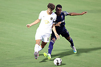 CARY, NC - AUGUST 01: Eli Crognale #12 is defended by Dre Fortune #8 during a game between Birmingham Legion FC and North Carolina FC at Sahlen's Stadium at WakeMed Soccer Park on August 01, 2020 in Cary, North Carolina.