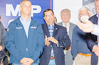 A cardboard cutout of US president Donald Trump stands in the corner near campaign signs during a Trump campaign office opening party in Salem, New Hampshire, on Fri., Sept. 18, 2020. Former 2016 Trump campaign manager and current 2020 Trump campaign senior advisor Corey Lewandowski (left), lives in nearby Windham, NH, spoke at the event, which also doubled as a surprise birthday celebration for Lewandowski.