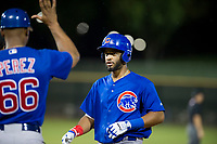 AZL Cubs right fielder Jonathan Sierra (22) talks to assistant hitting coach Leonel Perez (66) at first base during Game Three of the Arizona League Championship Series against the AZL Giants on September 7, 2017 at Scottsdale Stadium in Scottsdale, Arizona. AZL Cubs defeated the AZL Giants 13-3 to win the series two games to one. (Zachary Lucy/Four Seam Images)