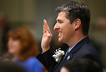 Nevada Assemblyman James Healey, D-Las Vegas, takes the oath of office during the opening day of the 77th Legislative Session in Carson City, Nev. on Monday, Feb. 4, 2013. (AP Photo/Cathleen Allison)