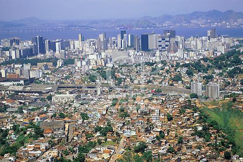 Rio de Janeiro, Brazil. Favela Dona Martha; edges of the shanty town with Sambadrome, downtown area and Niteroi Bridge.