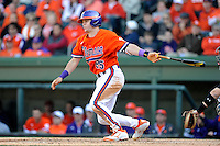 Freshman catcher Chris Okey (25) of the Clemson Tigers in the Reedy River Rivalry game against the South Carolina Gamecocks on March 1, 2014, at Fluor Field at the West End in Greenville, South Carolina. South Carolina won, 10-2.  (Tom Priddy/Four Seam Images)