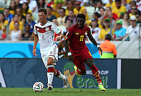 Mesut Ozil of Germany and Sulley Muntari of Ghana in action