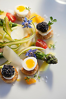 Green asparagus, Aquitaine caviar and soft-boiled quail eggs, dressed with barrel-aged balsamic vinegar and Parmigiano-Reggiano, prepared by head chef Philippe Jégo at restaurant 'Les Pêcheurs', Cap d'Antibes Beach Hotel, Antibes, France, 26 April 2012
