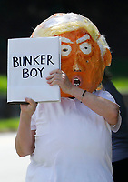 Protesters gather outside Trump National Golf Club Washington DC in Sterling, Virginia while United States President Donald J. Trump plays golf on June 21, 2020. <br /> Credit: Yuri Gripas / Pool via CNP/AdMedia