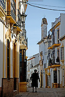 Woman walking down an alley, Ronda, Andalusia, Spain.