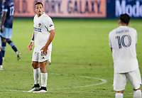 """CARSON, CA - OCTOBER 18: Javier """"Chicharito"""" Hernandez #14 and Cristian Pavon #10 of the Los Angeles Galaxy exchange a few words with one another during a game between Vancouver Whitecaps and Los Angeles Galaxy at Dignity Heath Sports Park on October 18, 2020 in Carson, California."""