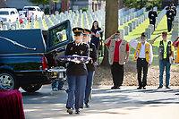 The remains of 2nd Lt. Henry Donald Mitchell are carried Tuesday, Sept. 14, 2021, during a military burial ceremony for Mitchell in at the Fayetteville National Cemetery. Robert Mitchell, 90, of Fort Smith led a decades long effort to find the remains of his brother, whose plane went down July 8, 1944 over Austria during World War II, and have to them returned to Arkansas for burial. Visit nwaonline.com/210915Daily/ for today's photo gallery.<br /> (NWA Democrat-Gazette/Andy Shupe)