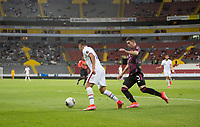 , MEXICO - : Sebastian Saucedo #10 of the United States dribbles with the ball past Manuel Mayorga #3 of Mexico during a game between  and undefined at  on ,  in , Mexico.