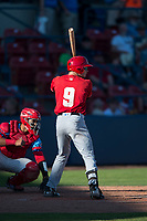 Vancouver Canadians right fielder Griffin Conine (9) at bat in front of catcher Isaias Quiroz (11) during a Northwest League game against the Spokane Indians at Avista Stadium on September 2, 2018 in Spokane, Washington. The Spokane Indians defeated the Vancouver Canadians by a score of 3-1. (Zachary Lucy/Four Seam Images)