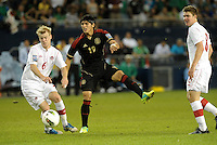Alan Pudio (19) Mexico has a shot on goal... Mexico defeated Canada 3-1 in Olympic Qualifying semi final at LIVESTRONG Sporting Park, Kansas City, Kansas.