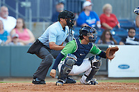 Gwinnett Stripers catcher John Ryan Murphy (12) sets a target as home plate umpire Charlie Ramos looks on during the game against the Scranton/Wilkes-Barre RailRiders at Coolray Field on August 16, 2019 in Lawrenceville, Georgia. The Stripers defeated the RailRiders 5-2. (Brian Westerholt/Four Seam Images)